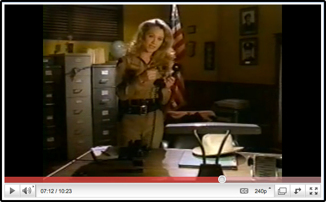 Christine Taylor Holds The Phone